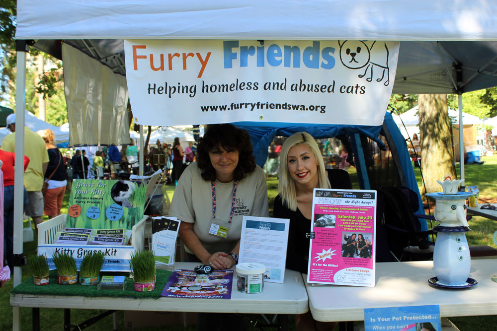 Sandy Bush and Tess Ewart at the Recycled Arts Festival, at the Furry Friends booth