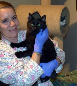 Foster mom Dena Hugh holding Brandy