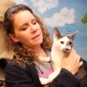 Dena Hugh Foster Assistant holding Cleo