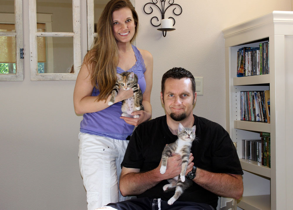 Rachel and her husband holding kittens