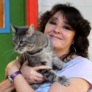 Licensed Vet Tech, Medical lead Sandra Bush holding a cat