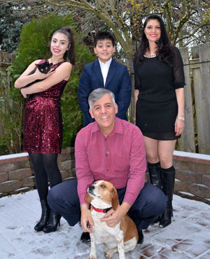 2019 Serrano family Christmas picture with their pets
