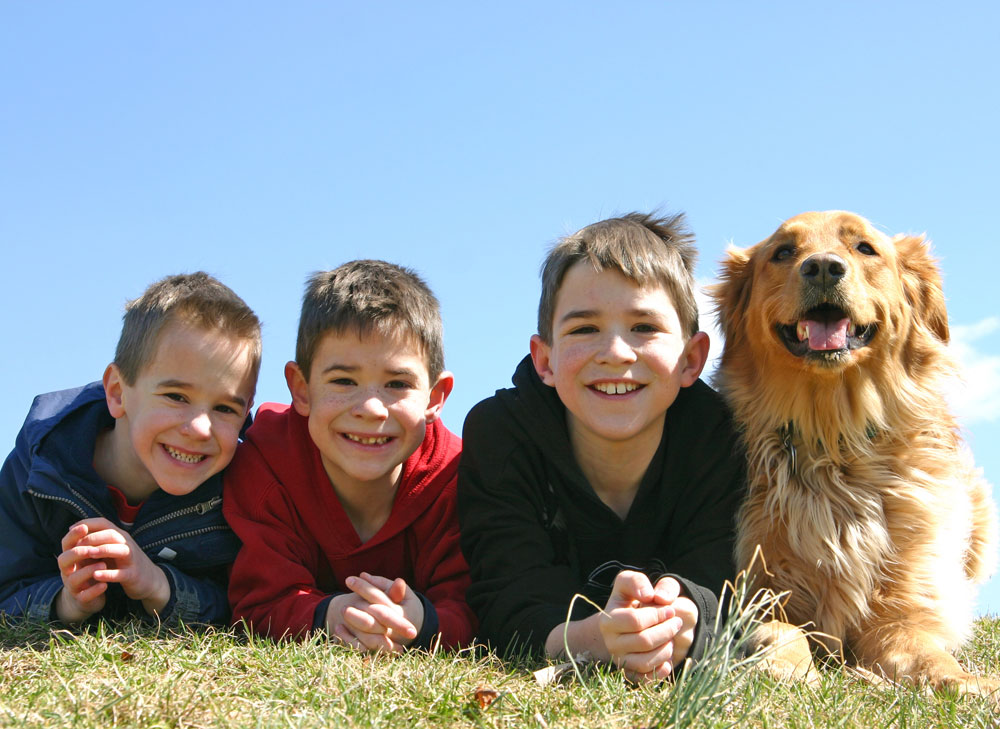 Smiling children with a dog