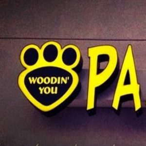 Woodin You Pampered Paws logo with yellow paws